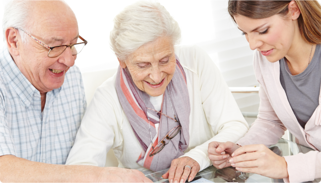 caregiver assisting elderly couple