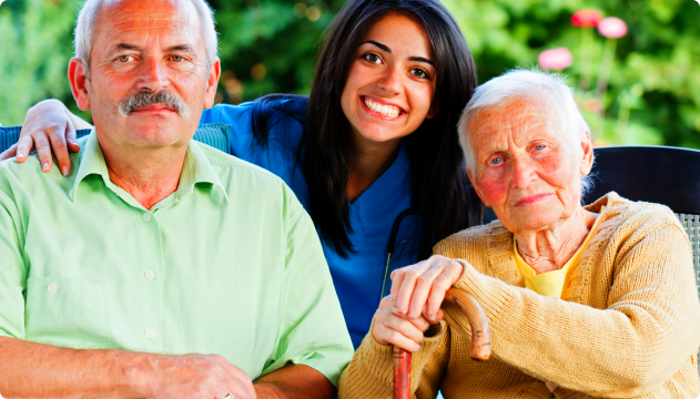 caregiver with an elderly couple